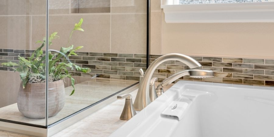 Glass Tile Along Bathroom Sink And Counter.